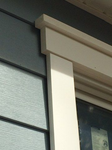 Installation of Royal Celect Siding with white color around the