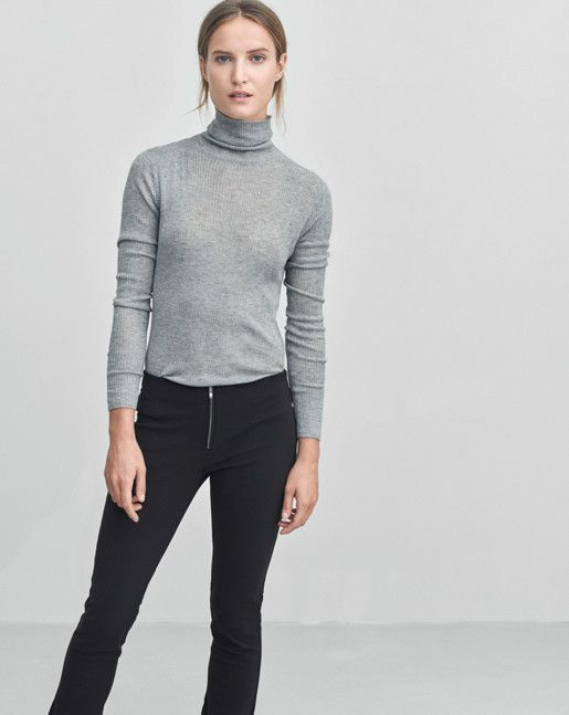 Luxe slim fitted roller in light weight tencel wool yarn. Long slim sleeves and a fine sheer quality. Wear on its own or as a layering piece. <br><br> - Soft lyocell wool<br> - Slim fit<br> - Long slim sleeves<br><br> The model is 177cm and wears siz