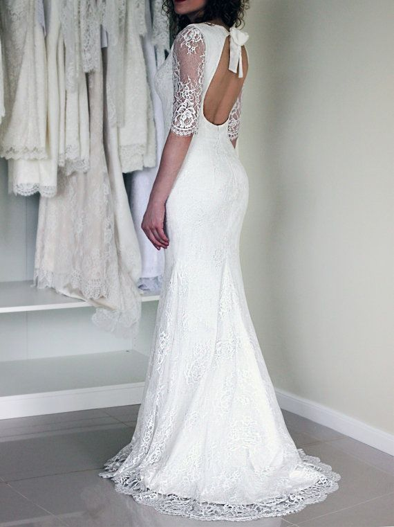 Lace wedding dress in a trumpet silhouette with open back and 3/4 ...