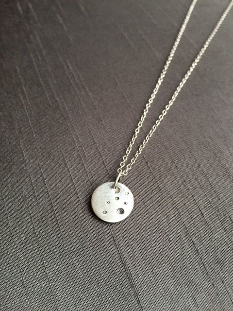 """Minimalist style:Handcrafted in fine silver (.999%), this Tiny Crater Moon hangs at 17"""" on a delicate sterling silver chain. ($28) Perfect everyday wear! #moonpendants #moonjewelry #modernjewelry"""