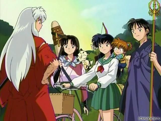 InuYasha with a torn sleeve, Sango with Kirara, Kagome holding her bike with Shippo on her shoulder, and Miroku - screenshot from InuYasha