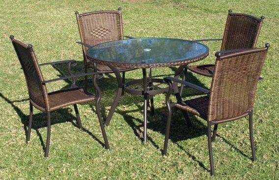 mesa redonda cristal sillas terraza