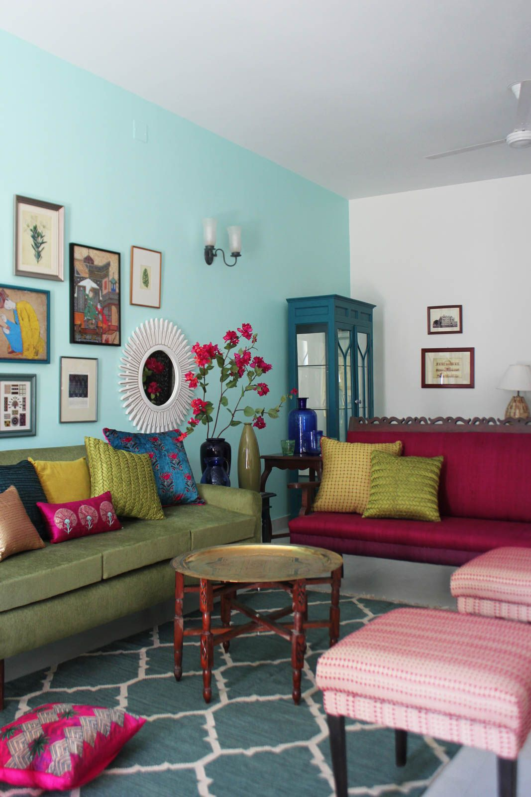 the gallery wall in the living room of patricia and mathai