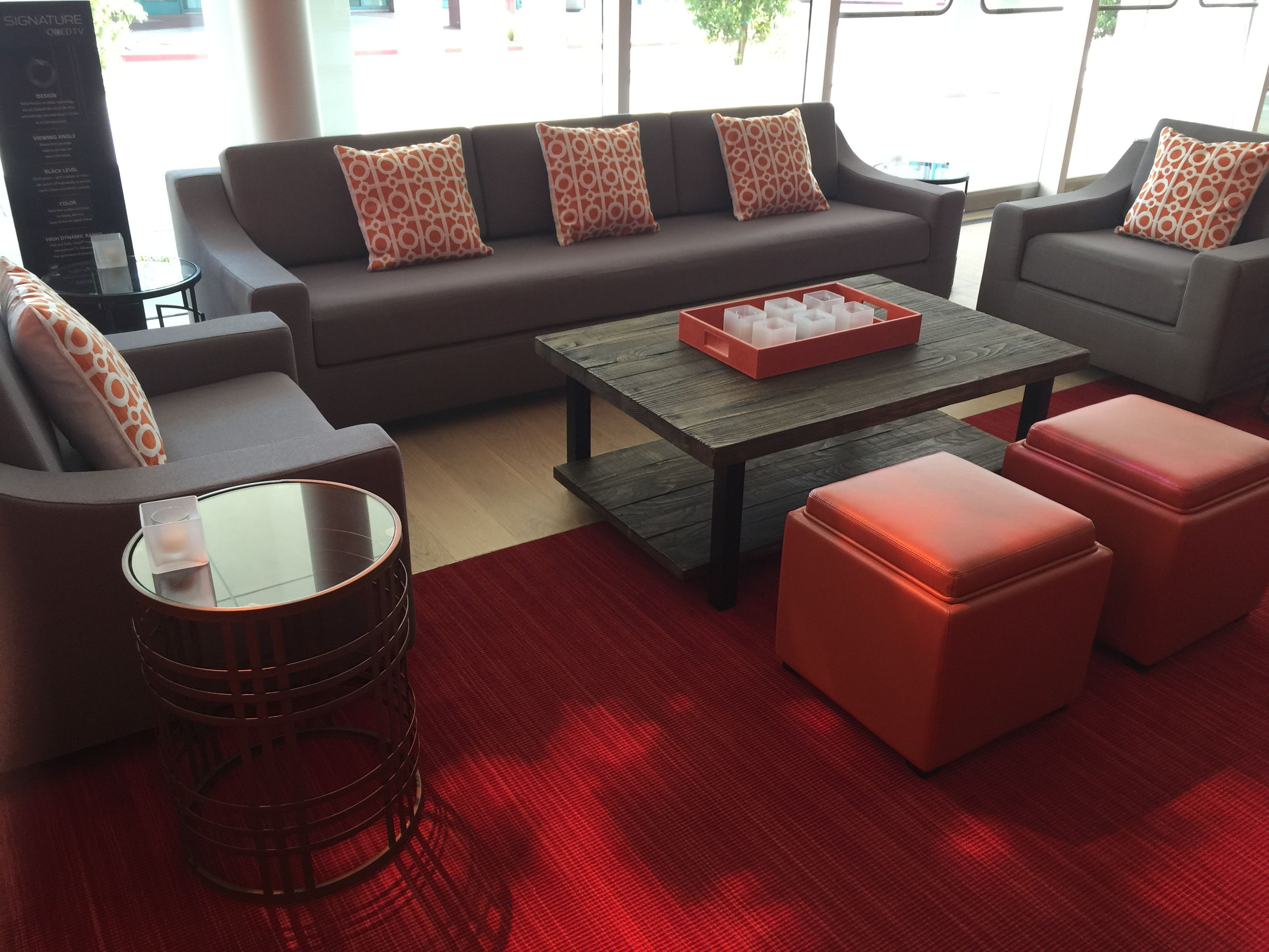 ottoman for living room%0A Pale Grey with vibrant orange accents  Pillows  Leather Ottomans  u     trays