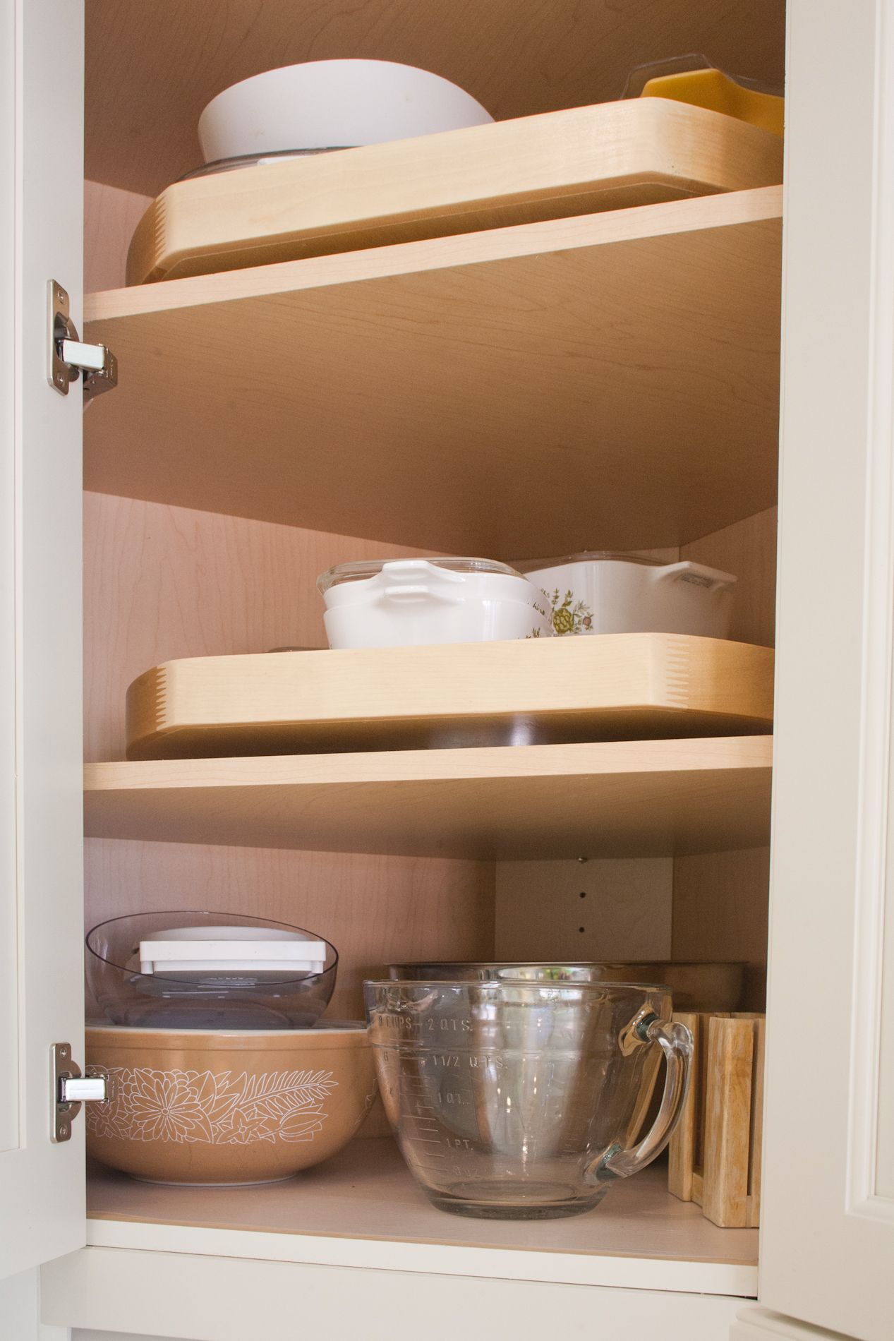 Lazy susan in angled corner wall cabinet organization ...