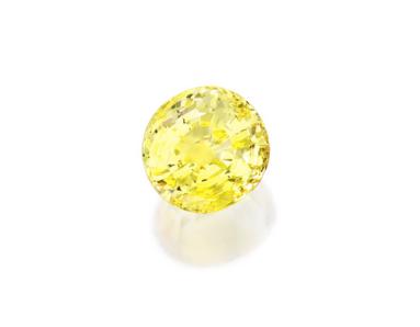 important saphir jaune sur papier de 78,29 carats, certifié naturel et non traité par le GIA. Estimation entre 50.000 et 70.000 $.