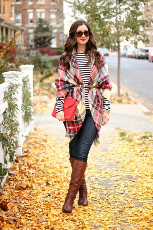 A belted plaid blanket scarf over a striped T-shirt ...