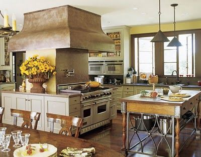 This kitchen is huge! With two islands and a dining table- it doesn