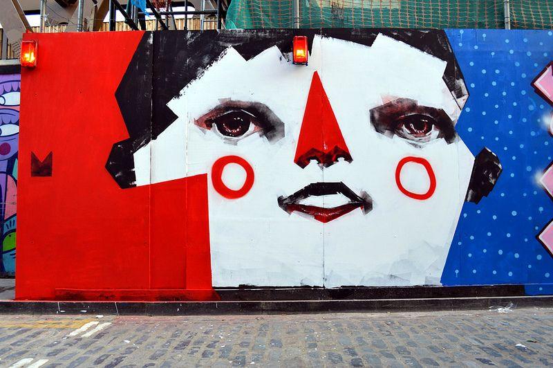 Street art on Brick Lane Street, London, by Rodrigo Branco