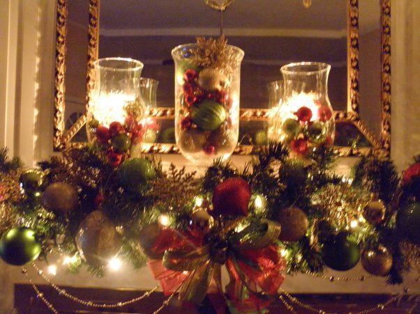 Christmas Mantle using hurricane glass The Beauty of Christmas