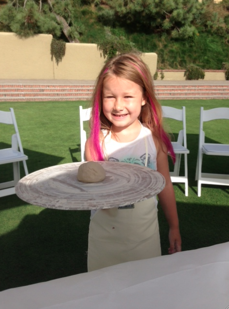 Stella showing her project from pottery class