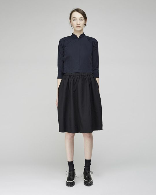 Shop this look on Lookastic: https://lookastic.com/women/looks/navy-long-sleeve-blouse-black-midi-skirt-black-oxford-shoes-black-socks/9163   — Navy Long Sleeve Blouse  — Black Pleated Midi Skirt  — Black Socks  — Black Leather Oxford Shoes