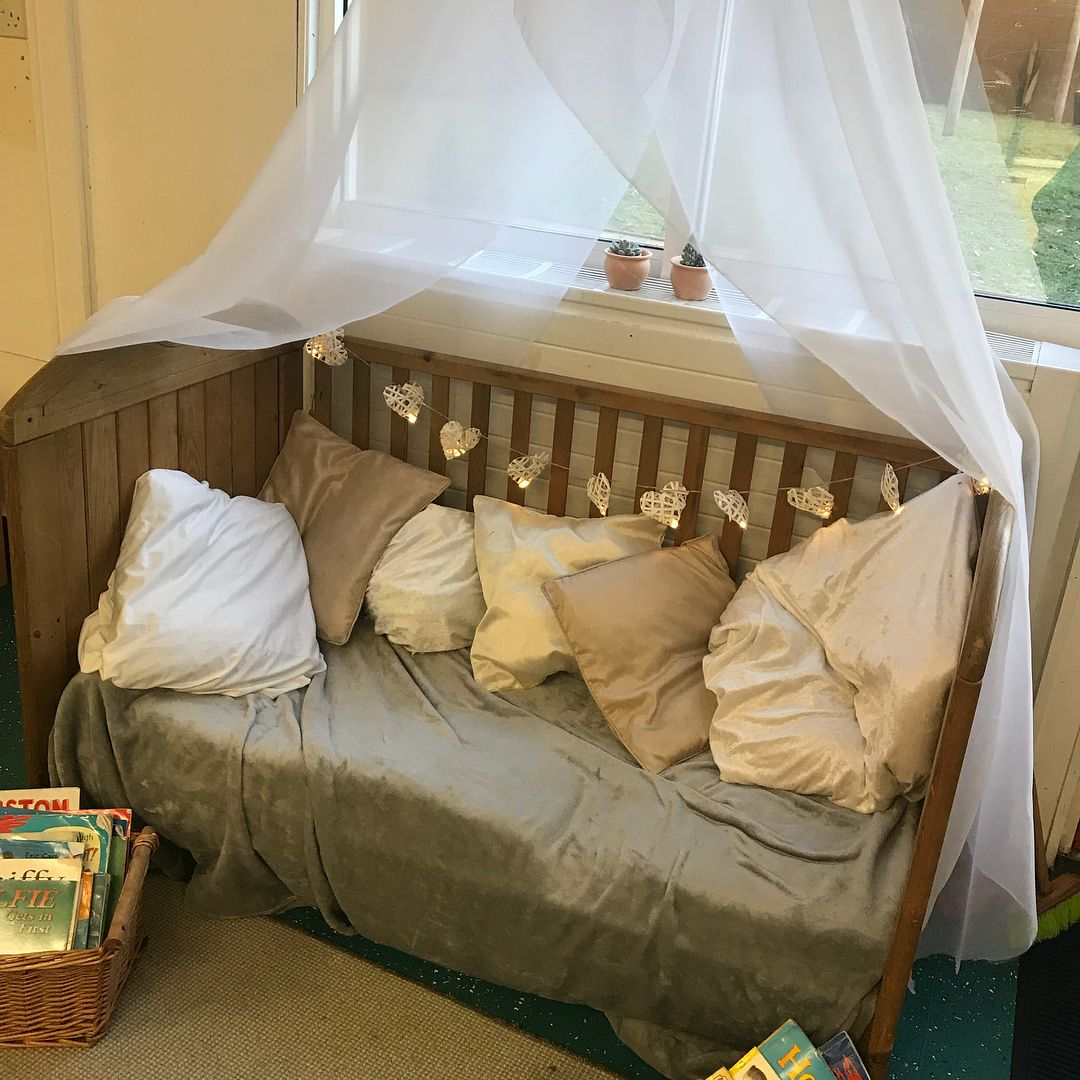 A Cosy Reading Area Using An Old Cot Eyfs