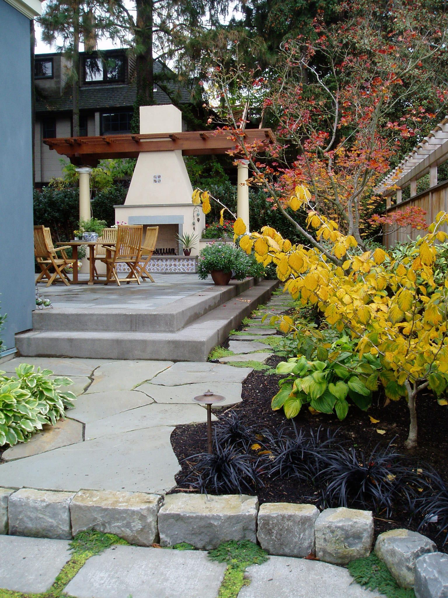 fire place helps complete outdoor dining area adjacent to dinning