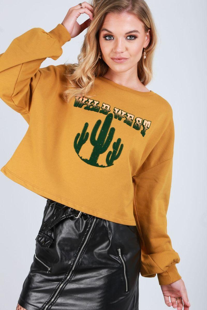 b7ba81c18bb ELLA CROPPED SWEATSHIRT £18.00 Up your casual wardrobe in this wil west  slogan jumper!