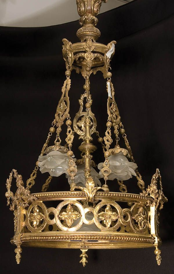 A FRENCH LOUIS XVI GILT BRONZE AND ART GLASS CHANDELIER 19th century, with four floriform blown shades above a reticulated gilt bronze frame.