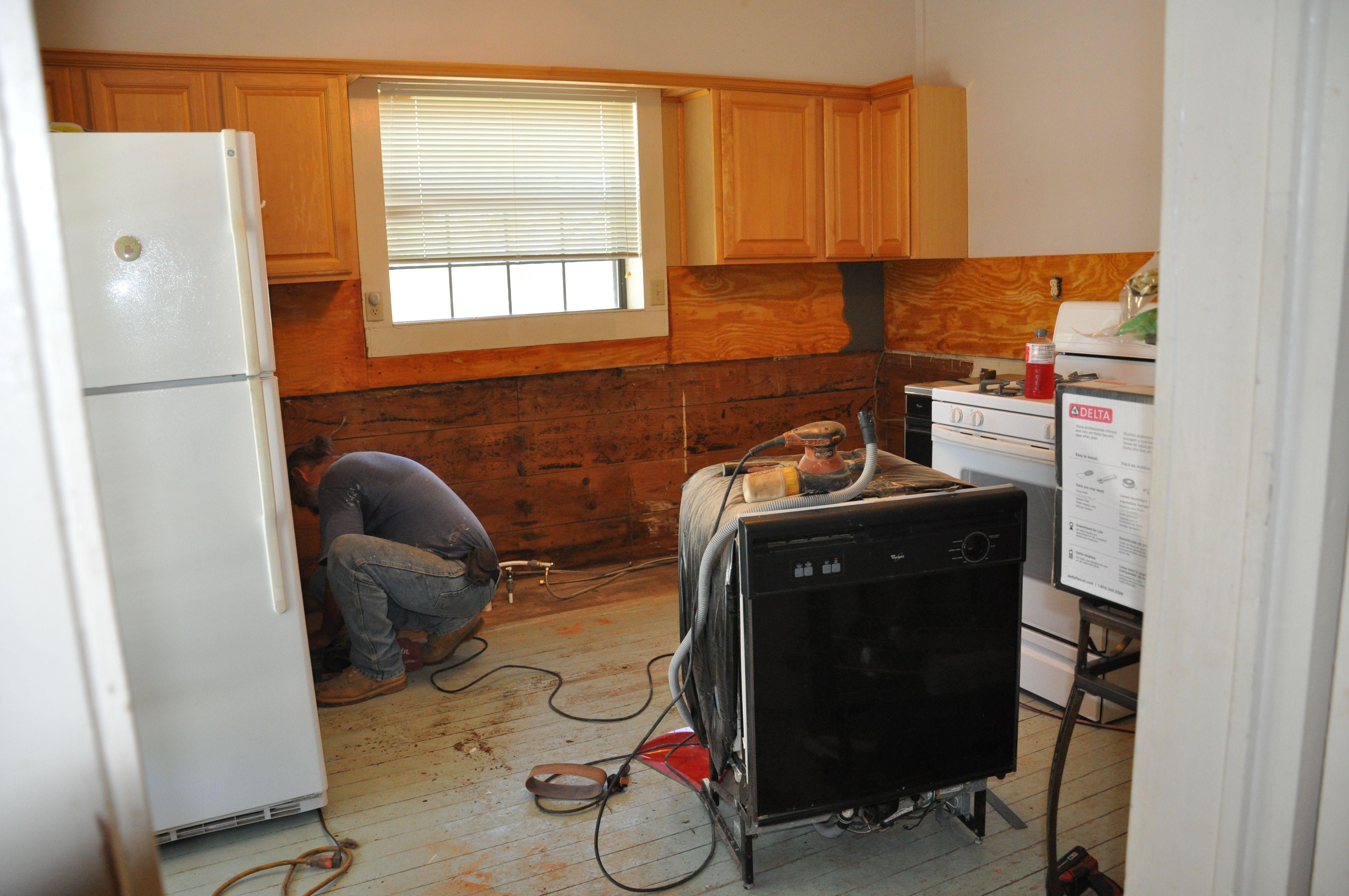 Demolition in progress....bye-bye rotten bottom cabinets ...
