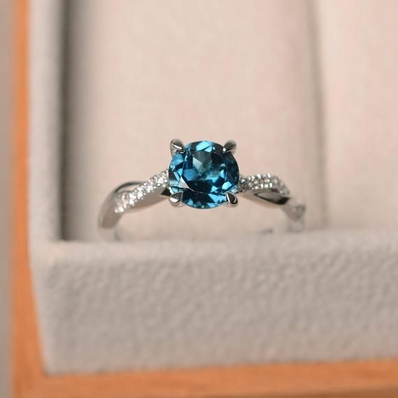Photo of Real London blue topaz rings, promise rings, round cut blue gems, silver rings