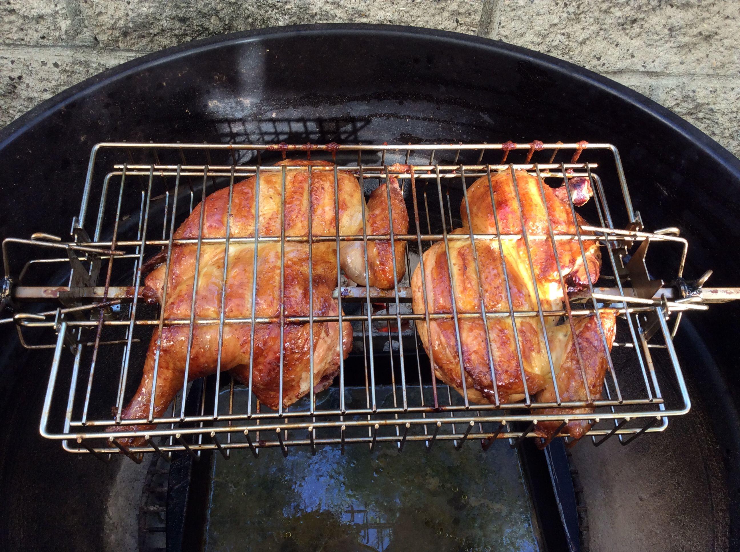 Cornell BBQ chicken in a rotisserie basket.