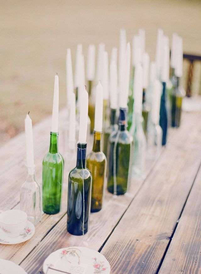 12 DIY Candle Holders: Bottle Centerpiece - this could be beautiful for fall!