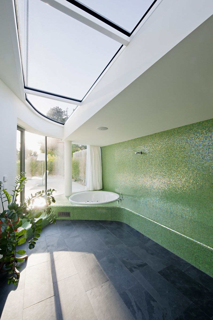 I Love The Tiled Wall And Enormous Skylights In This House.