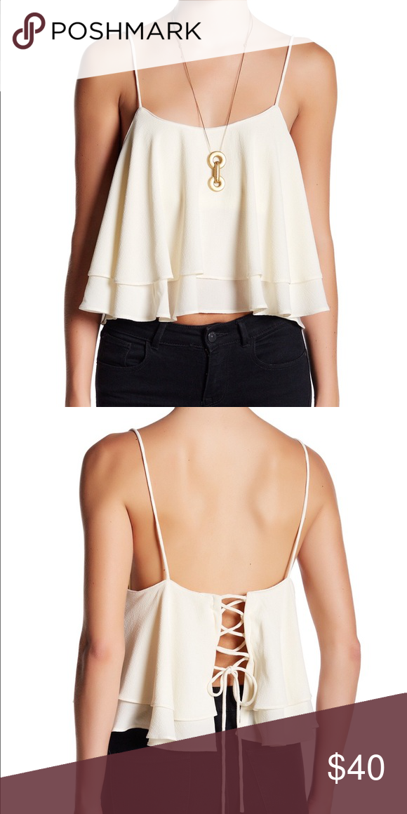 "💫DEAL OF THE DAY💫{Free People Top} Scoop neck. Sleeveless. Self-tie lace-up back. Tiered flounce design. Lined. Approx. 21.5"" length. Shell: 92% polyester, 8% spandex. Lining: 95% cotton, 5% spandex. Free People Tops"