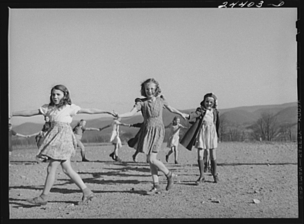 Children playing a singing game during afternoon play period at homestead school. Wes... Arthur Rothstein December 1942