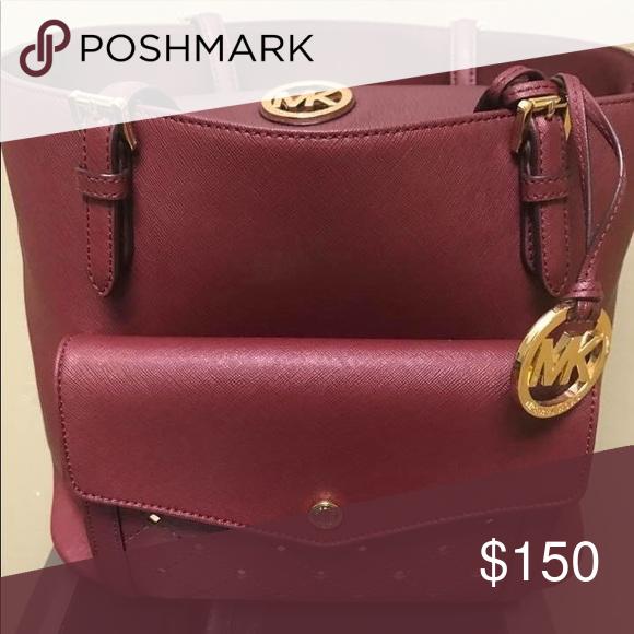 b7367d7c189 MK pocketbook and matching wallet Gently used beautiful maroon color KORS  Michael Kors Bags Shoulder Bags