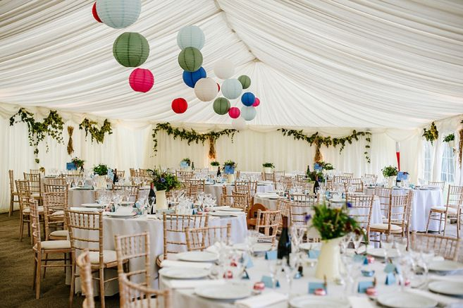 Marquee decorated with hops and paper lanterns  | Photography by http://www.jmcsweeneyphotography.co.uk/