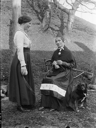 Portrait of two women knitting