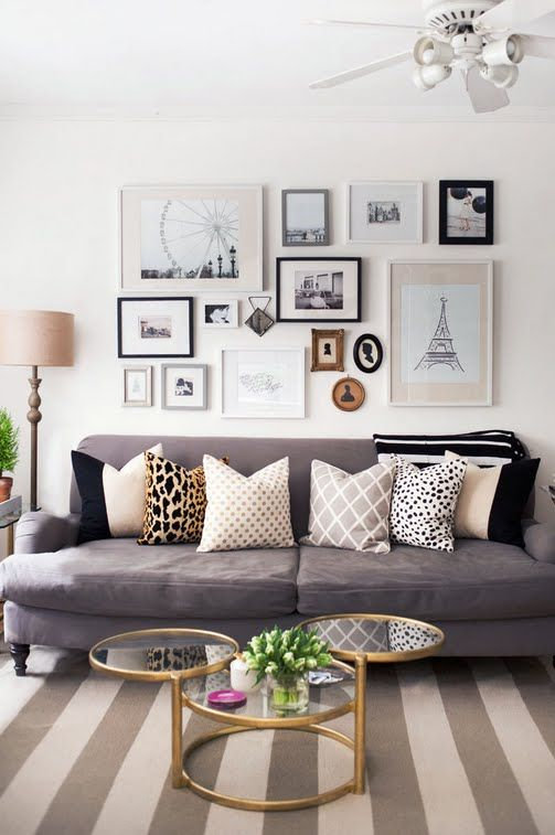 Pretty! Gallery wall above the couch, the table, the rug, i love it all!