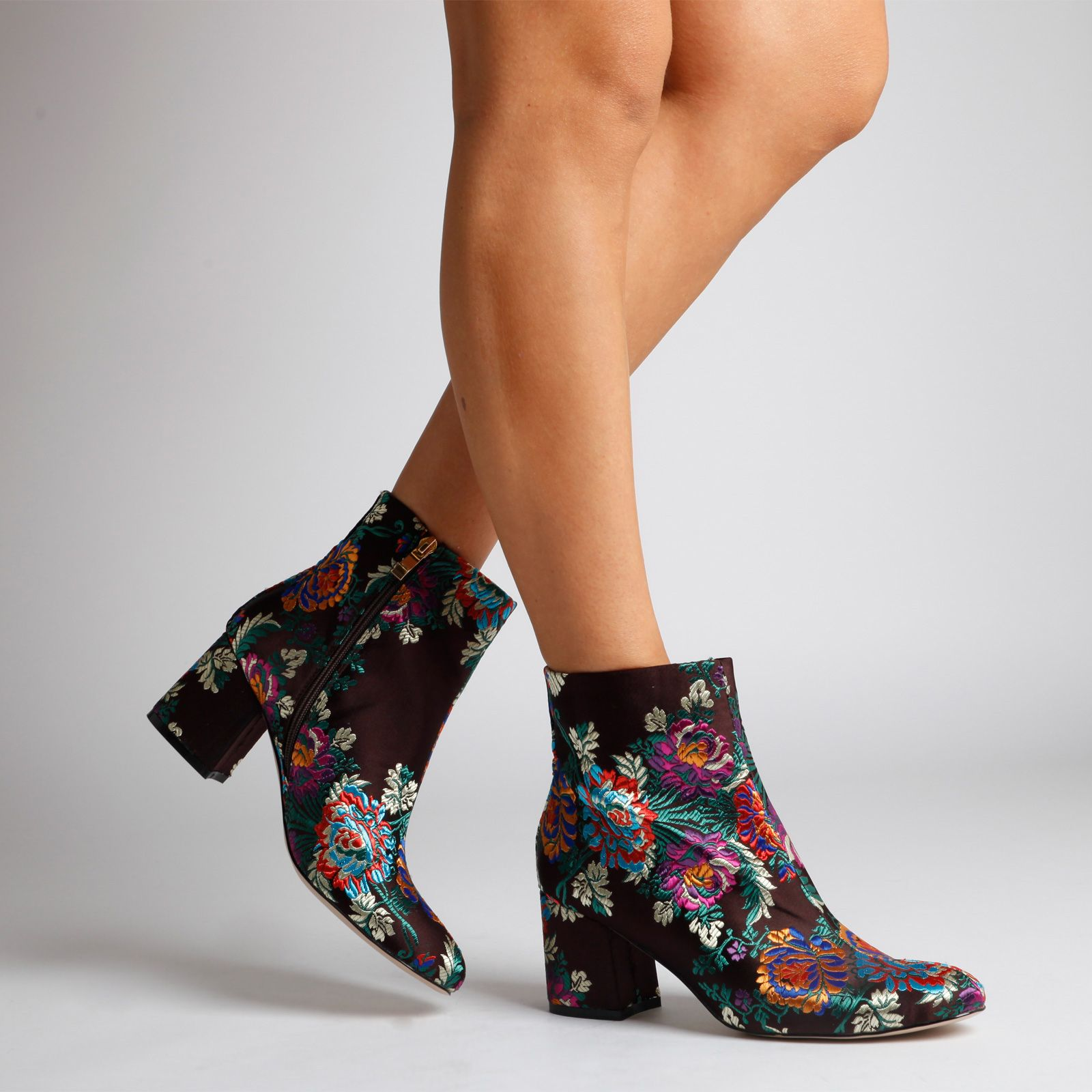 The absolute perfect style setting ankle boot to step into fall. With it's floral embroidered finish, luxurious feel and midi heel height, it's that key shoe piece. Available in sizes UK 3-14