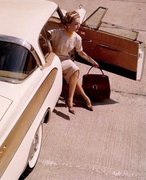 Model in a 1958 Packard Hawk, wearing a necklace by Verdura; handbag by Gucci, 1958