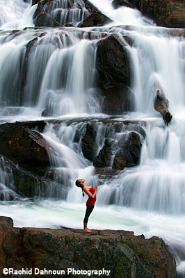A Woman Performs Yoga Under Waterfall In Lake Tahoe Ca Waterfall South Lake Tahoe Travel Photography