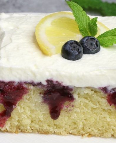 Blueberry Lemon Poke Cake – bursting with irresistible lemon and blueberry flavor. The lemon cake is poked with holes, and drizzled with lemony and sweet blueberry sauce, then topped with whipped cream. So Good! Perfect for a holiday party! Easy recipe. Vegetarian. Video Recipe | Tipbuzz.com #cinnamonrollpokecake