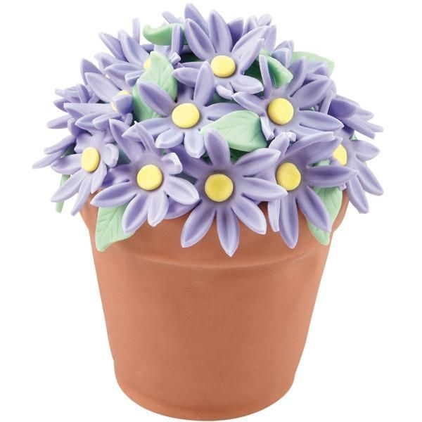 103 Wilton Purple Rose Cupcakes | Pretty purple daisies present the colors of spring. Make these mini ...