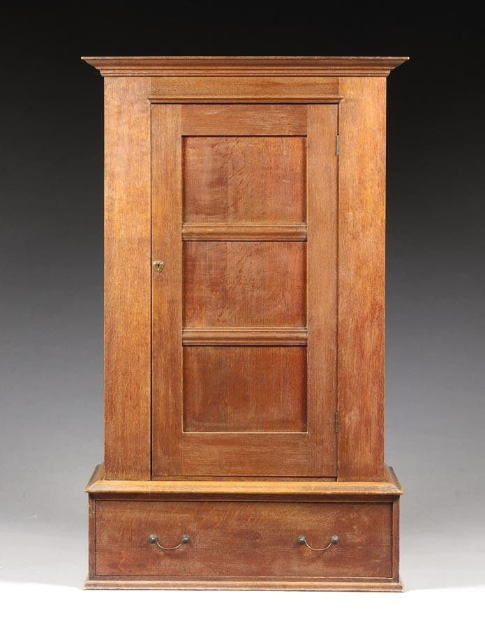 CHARLES FRANCIS ANNESLEY VOYSEY AN OAK WARDROBE  Part of a rare group of furniture removed from White Cottage, 68 Lyford Road, Wandsworth Common, London, SW18. White Cottage and its contents were designed by Voysey in 1903 for his friend C. T. Coggin.