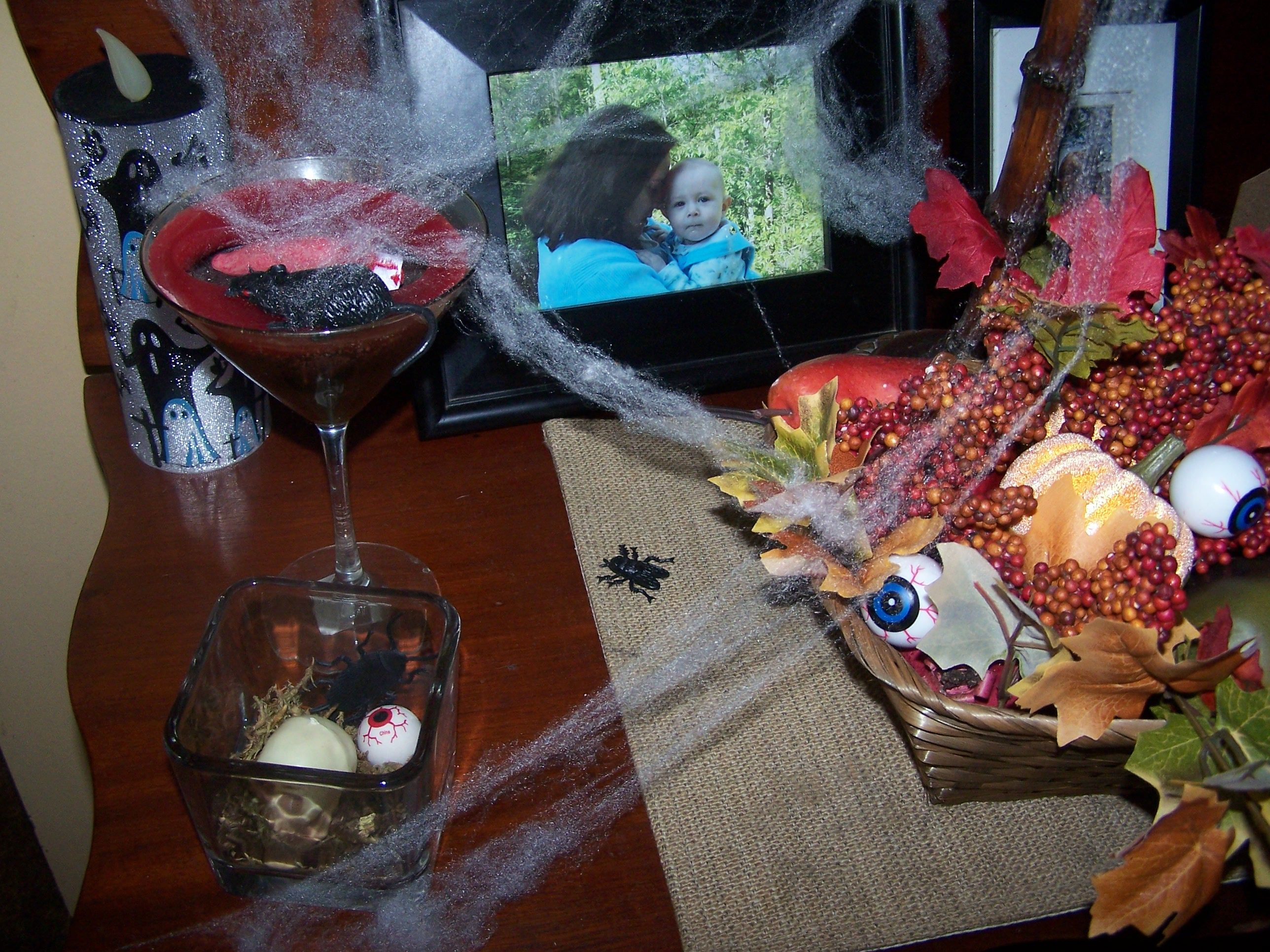 Glass with red candle, finger & sm. rat, eyeballs on my side table, used glass with moss, eyeball, skull and roach all from Dollar Tree