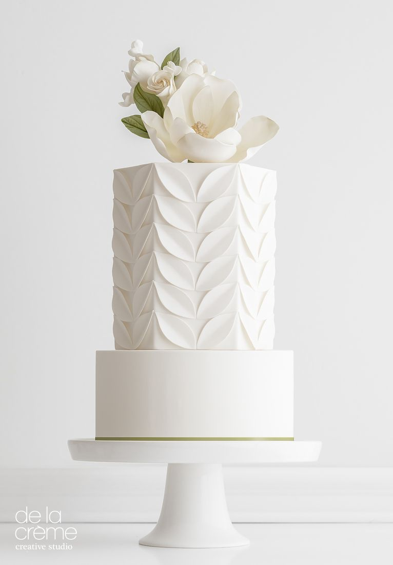 Elegant white wedding cake with large white flower cake topper by ...