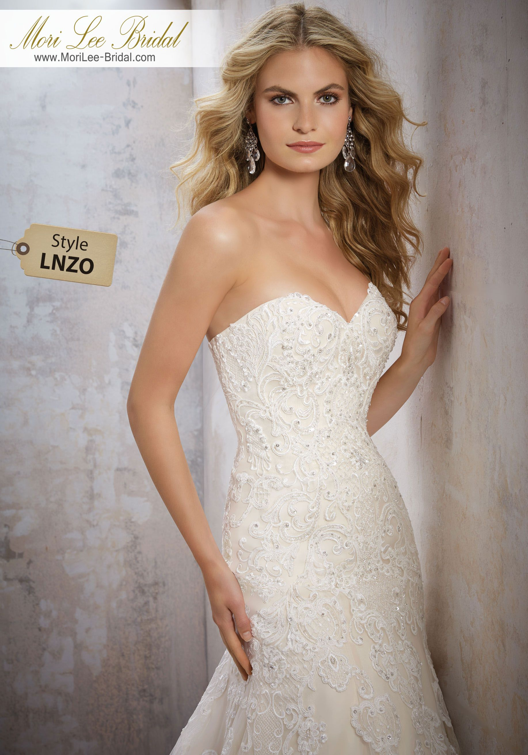 Dress style lnzo strapless bridal gown featuring a romantic