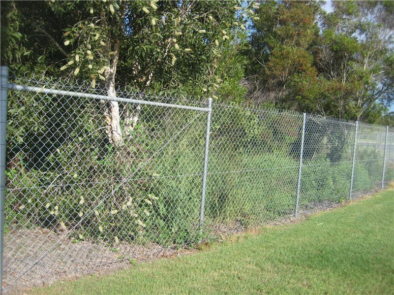 A simple galvanised Chainwire fence with barbs on the top