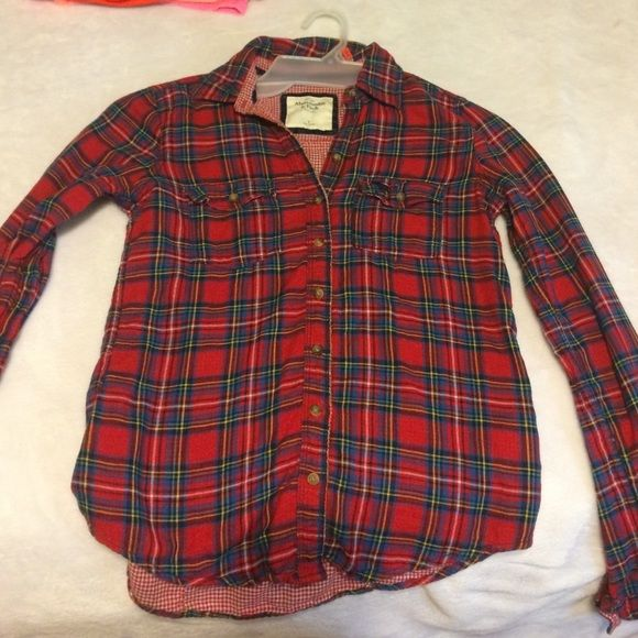 Plaid button down long sleeve shirt Button down shirt from Abercrombie and Fitch size small got for Christmas one year took off tags but never worn. Abercrombie & Fitch Tops Button Down Shirts
