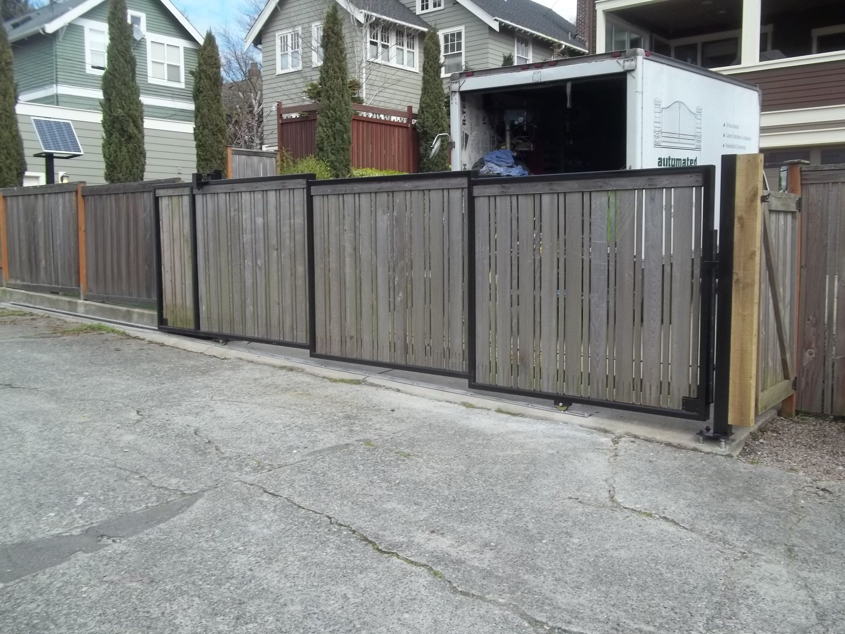 Tandem slide gate reusing the customer's existing wood fence panels.  #custom #entrance #gate #vehicle #wood #driveway #security #gate #upcycle #electric #automatic
