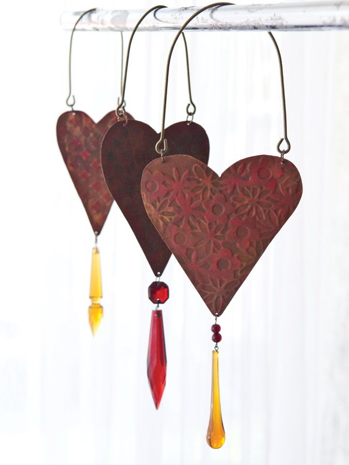 Melinda Barnett upcycled these garden art hearts from roof flashing with an embossing machine and a few chandelier crystals. | GreenCraft Magazine