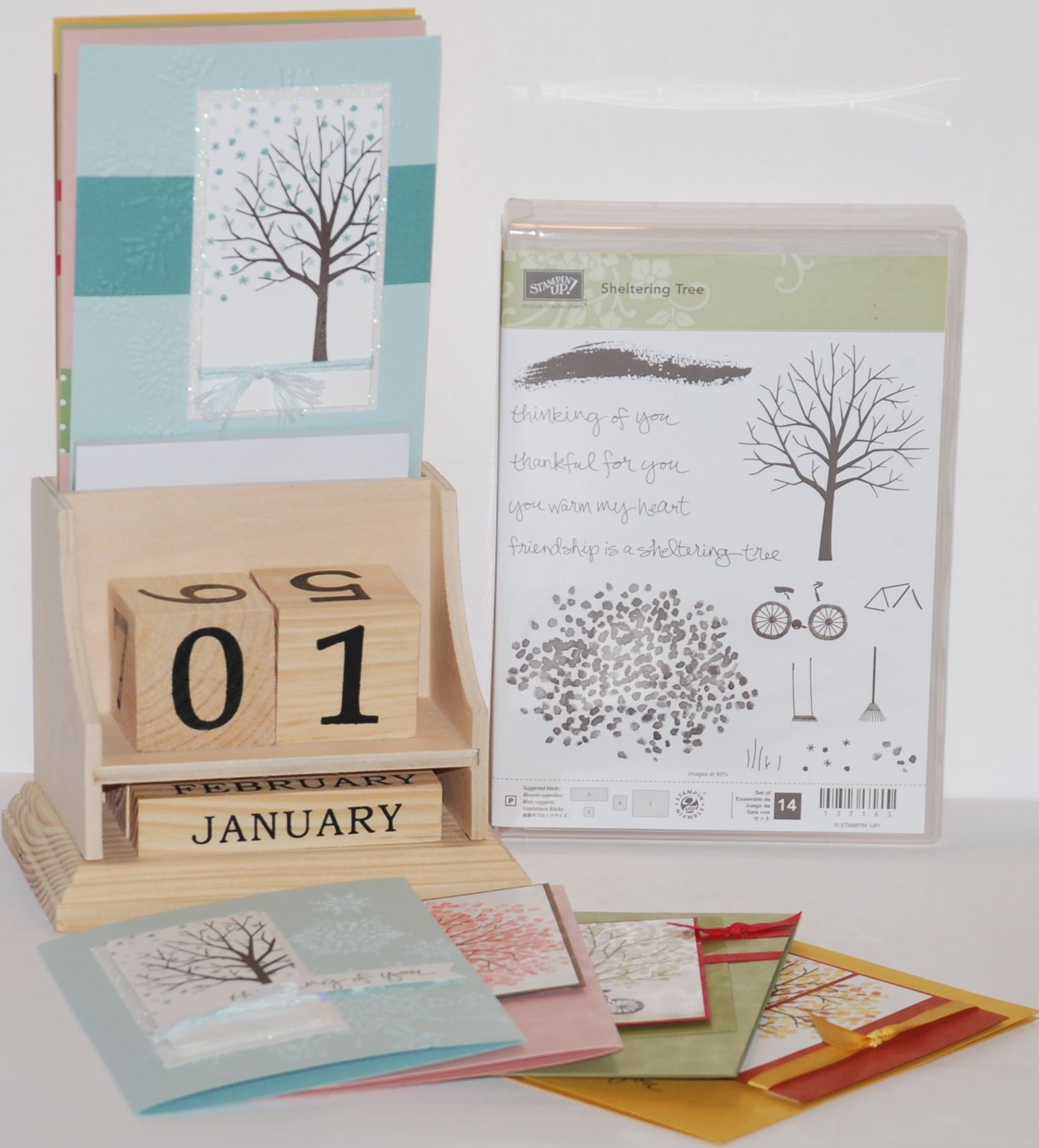 wooden calendar with seasonal inserts sheltering tree stamp set
