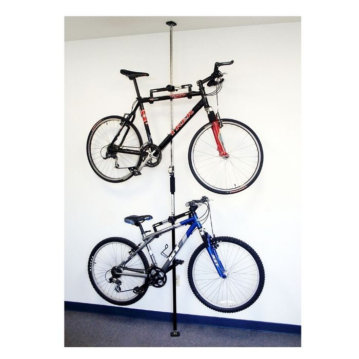 Q Rak Double Bike Rack Floor To Ceiling 89 99 Each Brookstone Need 2 Of These For The Garage Bike Storage Bike Storage Systems Bike Storage Rack