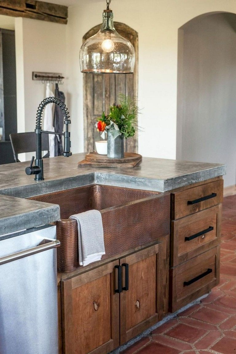 in the kitchen pictured above sophisticated earth tones and furniture style molding warm on kitchen decor over sink id=27647