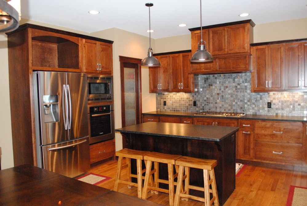 Kitchen with granite counter tops, tile backsplash. Neural, warm colors.   C&M Properties and Construction. www.candmhomebuilders.com Eau Claire, Wisconsin