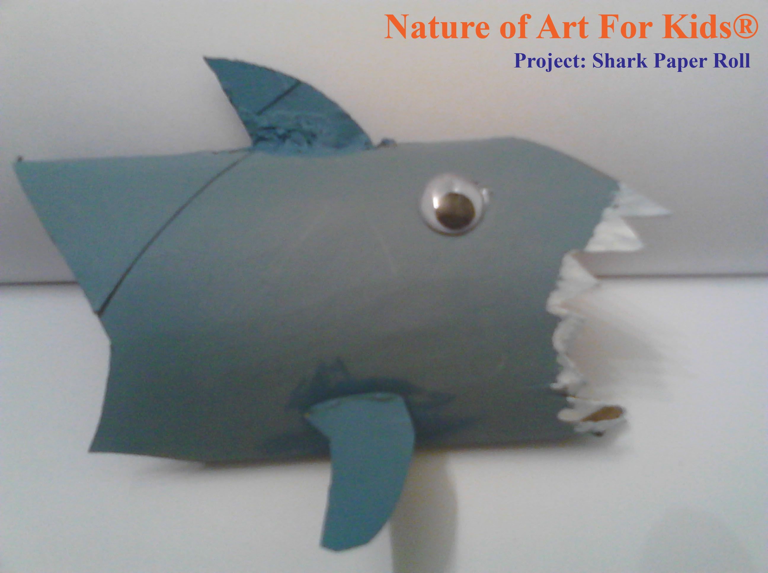 recycled shark alert art project for kids using recycled paper