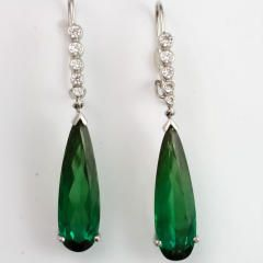 Luxurious green pear shape #tourmalines weighing 11.02 carats emit a stately presence in this pair of earrings. Accented by 0.41 carat of fine white diamonds, they add a classic touch to any look.